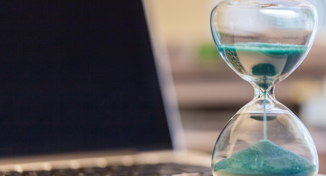 stock-photo-hourglass-on-laptop-computer